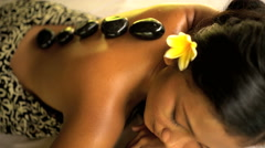 Beautiful Balinese female relaxing at luxury spa resort with cleansing and Stock Footage