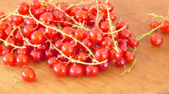 Red currants on wooden table. Harvest of garden berries. Stock Footage