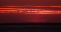 Snowscape and clouds under red sky after arctic sunset Stock Footage