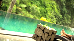 Beautiful Balinese female relaxing on vacation at tropical spa with refreshing Stock Footage