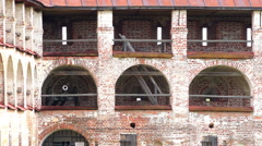 Vintage gun postwar shelled wall of red brick tower of the Monastery Stock Footage