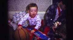 1973: kids with their new toys on christmas morning. LYNBROOK, NEW YORK Stock Footage