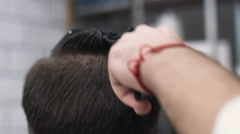Barber cuts the hair of the client with trimmer slow motion Stock Footage