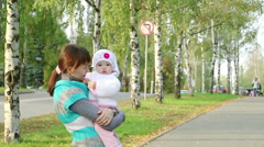 Beautiful mother and cute baby saw something interesting Stock Footage