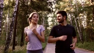 Portrait of a couple running joyfully in nature Stock Footage