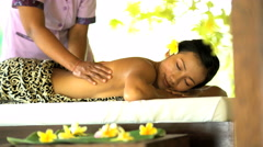 Holistic therapy for health and wellbeing by professional masseuse in serene Stock Footage