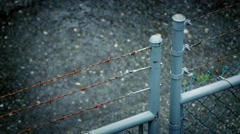 Barbed Wire Fence In Rainstorm Stock Footage