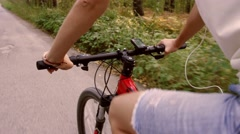 Close-up of woman riding a red bicycle on paved road Stock Footage