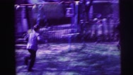 1973: kids running in suburban home's yard LYNBROOK, NEW YORK Stock Footage