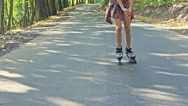 Legs of a young woman roller skating Stock Footage