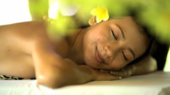 Reward of relaxing therapeutic massage for Asian female business traveller at Stock Footage