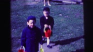 1973: happy kids playing with sand bucket LYNBROOK, NEW YORK Stock Footage