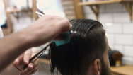 Barber cuts the hair of the client with scissors Stock Footage