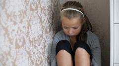 Little sad girl sitting on the floor Stock Footage