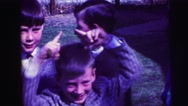 1973: children are seen having fun in garden area LYNBROOK, NEW YORK Stock Footage