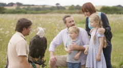 4K Family at a conservation centre looking at & learning about a bald eagle Stock Footage
