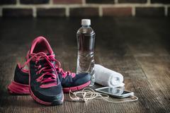 Fitness running sports equipment, sneakers water phone music towel Stock Photos
