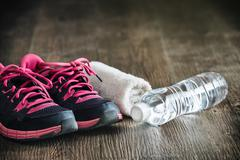 Fitness running sports equipment, sneakers water towel, healthy lifestyle Stock Photos