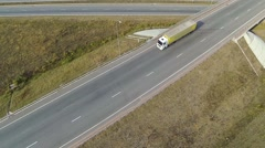 Aerial shot of highway junction, drone follow the truck Stock Footage