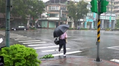 4k People in crosswalk on a street with Wind And Rain During A Typhoon-Dan Stock Footage