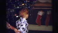 1973: little boy is trying to get his christmas sock LYNBROOK, NEW YORK Stock Footage