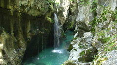 CLOSE UP: Scenic narrow gorge with waterfalls and river running through Stock Footage