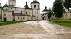 Early summer morning after the rain in the courtyard of a large Monastery Stock Footage