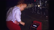 1973: christmas tree is seen with child opening presents LYNBROOK, NEW YORK Stock Footage