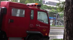 4K Red Firetruck Stop in the Street At Typhoon Day With Flashing Lights-Dan Stock Footage