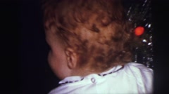 1973: excited child with christmas present LYNBROOK, NEW YORK Stock Footage