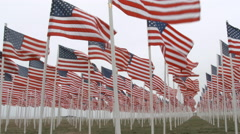 US Flags Waving At Fallen Soldiers Memorial Stock Footage