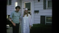 1974: high school graduation day daughter dad outside family bungalow home  Stock Footage