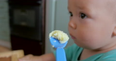 Spoon with food going to baby Mouth Stock Footage