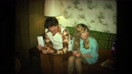 1974: 70's boomer generation youth and greatest generation older women  Stock Footage