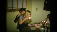 1974: young couple sharing chair and having dinner with the family FORT WAYNE Stock Footage