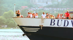 Passengers driving on the big boat at sea bay Stock Footage