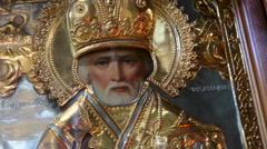 Holy saintly Nick icon in a gold coinage cover close up Stock Footage