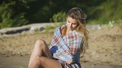 Beautiful girl sitting on wood. Travel and Vacation. Freedom Concept. Sensual Stock Footage
