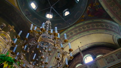 Interior of an old church altar chandelier lamp and arch and column Stock Footage