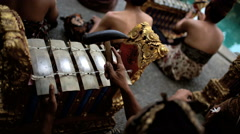 Asian Balinese musician gamelan group playing in traditional dress in a Stock Footage