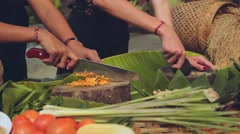 Bali cooking class close up, two women chopping and grinding Stock Footage