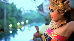 Balinese female artistic dancer performing in ceremonial traditional colorful Stock Footage