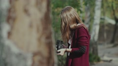 Girl with rarity camera walks in the woods. The girl with the camera Stock Footage