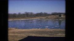 1974: view of people walking on frozen lake FORT WAYNE, INDIANA Stock Footage