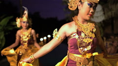 Balinese females performing artistic dance in ceremonial traditional colorful Stock Footage