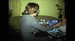 1974: mother feeding infant son baby food FORT WAYNE, INDIANA Stock Footage