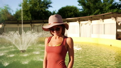 Girl in sunglasses and hat blowing a kiss. Stock Footage