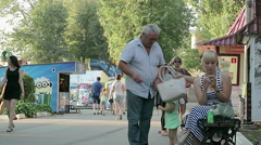 Children and adults in the park. Beautiful girl  Stock Footage