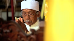 Bali - Balinese Priest at alter with incense performing marriage Stock Footage