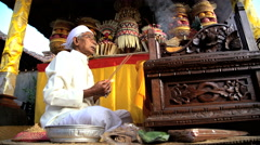 Bali - Balinese Priest at alter with incense performing  Stock Footage